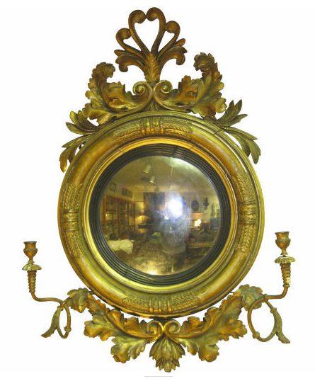 An English Regency mirrored girandole with convex bull's-eye mirror.